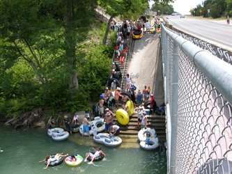 Put-In or Entry Point for the Horseshoe Loop section of the Guadalupe River. Easy entry for Tubers getting on the Guadalupe River, put your tube down in the water, turn around and plop right into your inner tube! Simple, easy and fun!