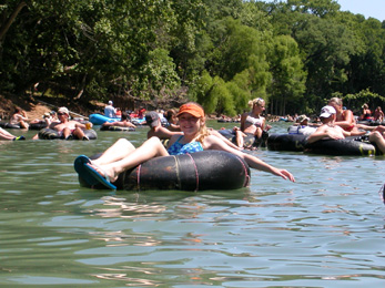 Kaisha tubing on the Horseshoe Loop section of the Guadalupe River with lots of other people!
