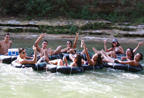 Happy Tubers Floating and Tubing down the Guadalupe River with Tube Haus, there is No Can Ban in Canyon Lake, TX.