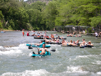Fun Rapids and lots of Tubers on a very scenic and beautiful Guadalupe River make for a great day of fun under the sun! Tube with the Good Guys, Tube Haus.com