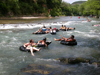 More Fun Rapids near the Tuber exit point on the Horseshoe Loop section of the Guadalupe River, TubeHaus.com  (830) 964-3011